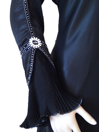 pleated bell sleeve on black abaya with crystal embellishments